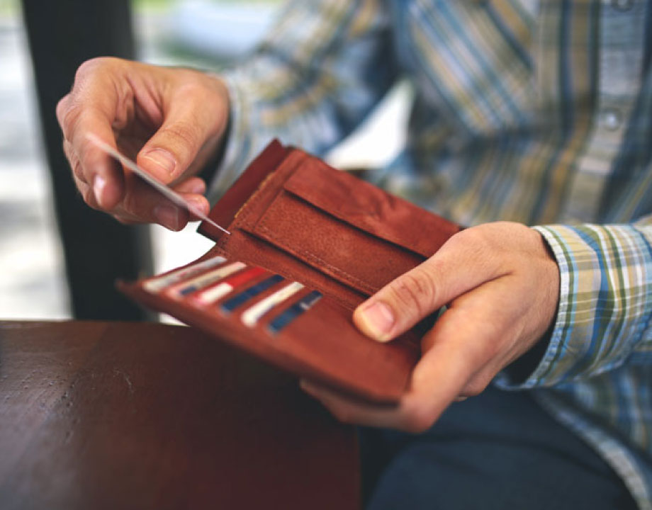 man pulling a card out of his wallet
