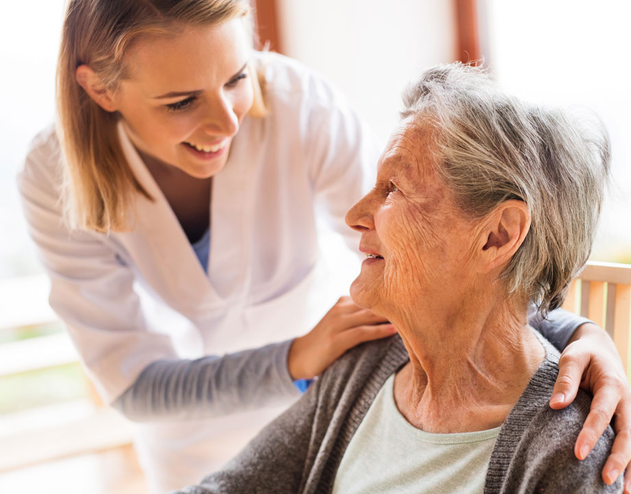 nurse talks to elderly woman