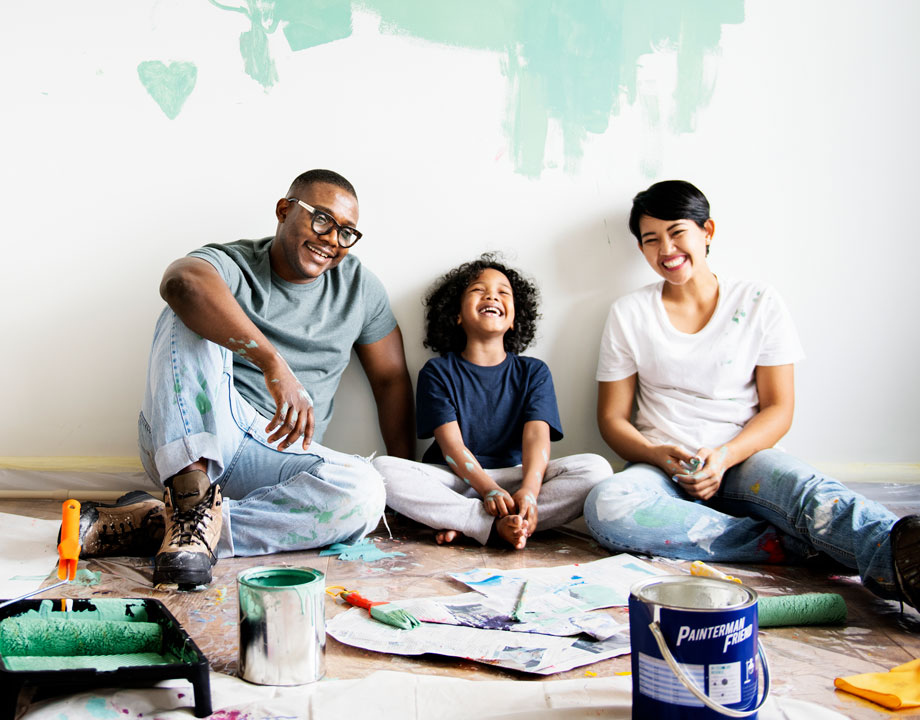 family smiling while renovating home